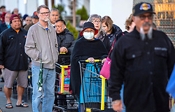 March 17, 2020, La Habra, California, USA:  Hundreds of seniors make their way toward the entrance of the Northgate Market in La Habra at sunrise on Tuesday, as the store opens at 7 a.m. The store opened to people over 65 before letting the rest of the public in to shop due to the coronavirus shopping craze. (Credit Image: © Mark Rightmire/Orange County Register via ZUMA Wire)