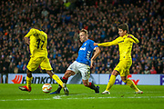 Scott Arfield (#37) of Rangers FC passes the ball past Karl Toko Ekambi (#17) of Villarreal CF during the Europa League group stage match between Rangers FC and Villareal CF at Ibrox, Glasgow, Scotland on 29 November 2018.