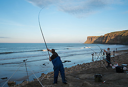 © Licensed to London News Pictures. <br /> 12/10/2014. <br /> <br /> Saltburn, United Kingdom<br /> <br /> Brad Morris from Redcar casts out from the beach during the annual Jim Maidens memorial beach fishing competition in Saltburn by the Sea in Cleveland. <br /> The competition is held each year to mark the death of Saltburn plumber and keen fisherman Jim Maidens who died in 1998 when he was killed after being swept overboard from his boat 'Corina' close to the beach at Saltburn.<br /> <br /> Photo credit : Ian Forsyth/LNP