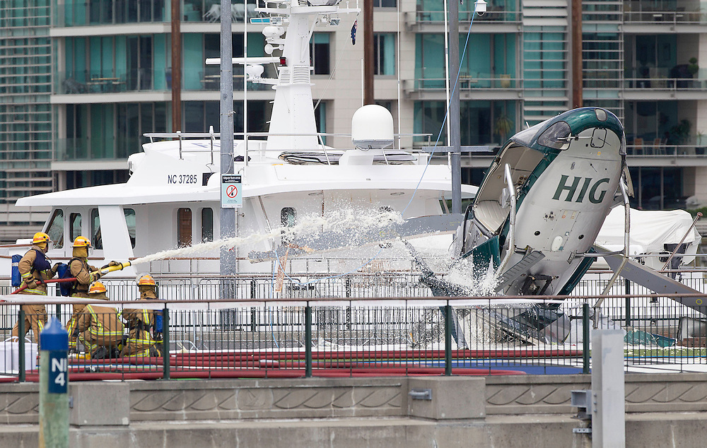 The Helisika helicopter which crashed on the Viaduct Basin while erecting the Telecom Christmas Tree, Auckland, New Zealand, Wednesday, November 23, 2011. Credit:SNPZ / Simon Runting