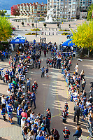 KELOWNA, BC - SEPTEMBER 29: The Vancouver Canucks' arrive at Prospera Place and sign autographs for a minor hockey team and fans prior to the game against the Arizona Coyotes on September 29, 2018 in Kelowna, Canada. (Photo by Marissa Baecker/NHLI via Getty Images)  *** Local Caption *** fans