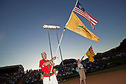 "May 29 - TEMPE, AZ: A man waves a ""Don't Tread On Me"" flag during a rally against illegal immigration in Tempe, AZ, Saturday. About 3,000 people attended a ""Buy Cott Arizona"" rally at Tempe Diablo Stadium in Tempe, AZ Saturday night. The rally was organized by members of the Arizona Tea Party movement to show support for Arizona law SB1070. The ""Buy Cott"" is a reaction to the economic boycott planned by opponents of SB1070. SB1070 makes it an Arizona state crime to be in the US illegally and requires that immigrants carry papers with them at all times and present to law enforcement when asked to. Critics of the law say it will lead to racial profiling, harassment of Hispanics and usurps the federal role in immigration enforcement. Supporters of the law say it merely brings Arizona law into line with existing federal laws.  Photo by Jack Kurtz"