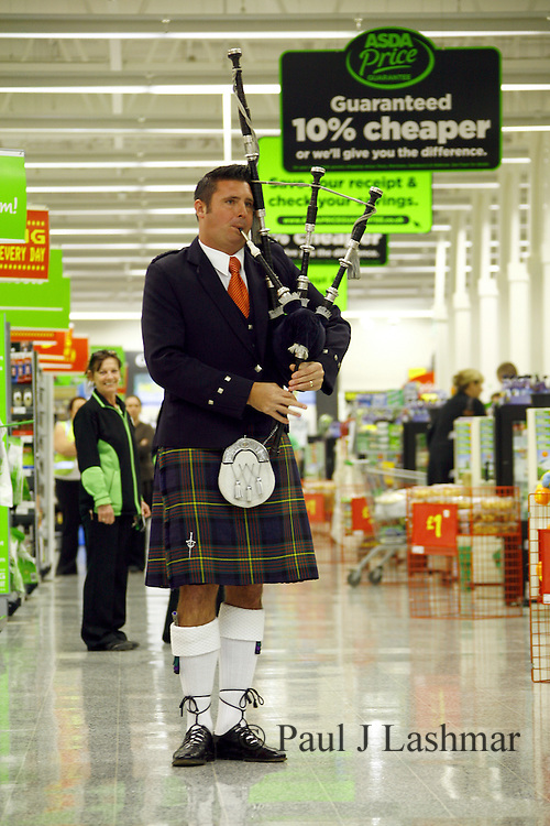 Piper Rob Muir inside the newly revamped ASDA store