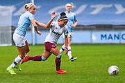 West Ham United Women forward Jacynta Galabadaarachchi (15) escapes Manchester City Women defender Steph Houghton (captain) (6) during the FA Women's Super League match between Manchester City Women and West Ham United Women at the Sport City Academy Stadium, Manchester, United Kingdom on 17 November 2019.