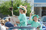BAR HARBOR, MAINE, July 4, 2014. Two artists dressed as the Statue of Liberty on the ArtWaves Studio float in the Independence Day Parade