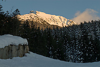 The flank of Whistler Mountain is lit by late afternoon winter sun.