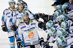 Gregor Baumgartner (EHC Liwest Linz, #79) celebrates with teammates during ice-hockey match between HDD Tilia Olimpija and EHC Liwest Black Wings Linz at fourth match in Semifinal  of EBEL league, on March 13, 2012 at Hala Tivoli, Ljubljana, Slovenia. (Photo By Matic Klansek Velej / Sportida)