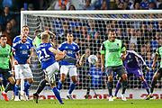 Ipswich Town midfielder Flynn Downes (21) shoots towards the goal during the EFL Sky Bet League 1 match between Ipswich Town and AFC Wimbledon at Portman Road, Ipswich, England on 20 August 2019.