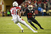 San Francisco 49ers wide receiver Jeremy Kerley (17) shakes Arizona Cardinals cornerback Marcus Cooper (41) at Levi's Stadium in Santa Clara, Calif., on October 6, 2016. (Stan Olszewski/Special to S.F. Examiner)