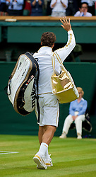 LONDON, ENGLAND - Monday, June 29, 2009: Roger Federer (SUI) walks off court following his Gentlemen's Singles 4th Round victory on day seven of the Wimbledon Lawn Tennis Championships at the All England Lawn Tennis and Croquet Club. (Pic by David Rawcliffe/Propaganda)