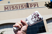 STARKVILLE, MS - SEPTEMBER 19:  Fan of the Mississippi State Bulldogs rings a cow bell before a game against the Northwestern State Demons at Davis Wade Stadium on September 19, 2015 in Starkville, Mississippi.  The Bulldogs defeated the Demons 62-13.  (Photo by Wesley Hitt/Getty Images) *** Local Caption ***