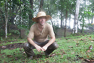 French Guyana. Amazonas forest and river. film shooting , extreme expeditions, Host Oliver (Olly) in  cisame camp in the jungle on the Approuague river in amazonia,      / Host Oliver (Olly) le camp cisame, dans la foret amazonienne au bord du fleuve Approuague en amazonie  guyane.
