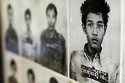 28 JUNE 2013 - PHNOM PENH, CAMBODIA:   Pictures of people killed by the Khmer Rouge at the Toul Sleng Genocide Museum. The Tuol Sleng Genocide Museum is in Phnom Penh. It is a former high school that was used as the Security Prison 21 (S-21) by the Khmer Rouge from 1975 to 1979. It was used to torture and execute Cambodians and foreigners the Khmer Rouge thought were opposed to the regime.    PHOTO BY JACK KURTZ