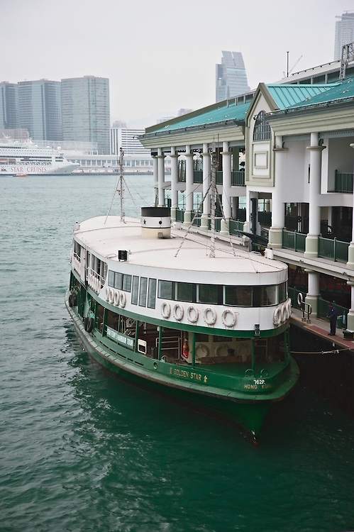 """Star line ferry """"Golden Star"""" preparing to depart Central pier in Hong Kong for trip across Victoria Harbour to Kowloon"""