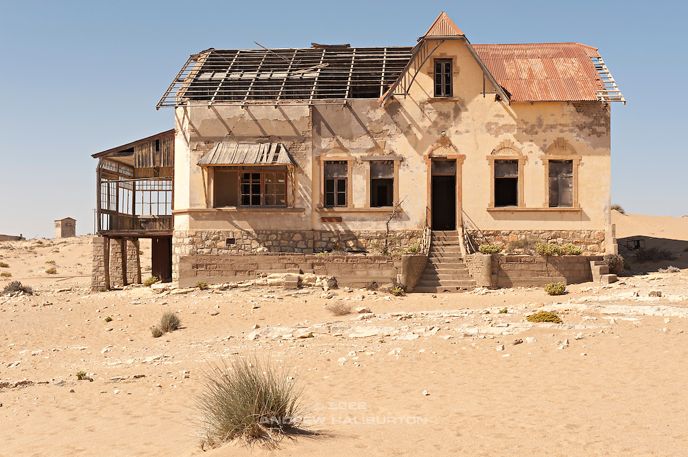 Near Lüderitz, lies Kolmanskop (or Kolmanskuppe), an abandoned diamond mining town from the early 1900's.  Abandoned in 1956, it has been invaded by the sand of the Namib Desert and is now a ghost town.  This is Buchhalter Wohnung, the bookkeeper's or accountant's home.