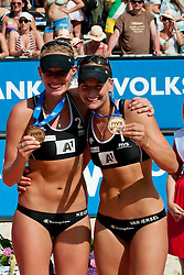 06-08-2011 VOLLEYBAL: FIVB WORLD TOUR GRANDSLAM: KLAGENFURT<br /> Third place for Marleen Van Iersel and Sanne Keizer of Netherland<br /> ©2011-FotoHoogendoorn.nl / Matic Klansek Velej