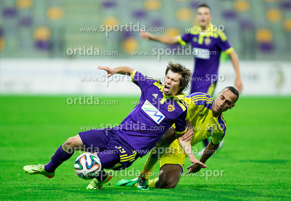 Damjan Bohar #39 of Maribor vs Maharan Radi of Maccabi during football match between NK Maribor and Maccabi Tel Aviv FC (ISR) in Third qualifying round of UEFA Champions League on July 30, 2014 in Stadium Ljudski vrt, Maribor, Slovenia. Photo by Vid Ponikvar / Sportida.com