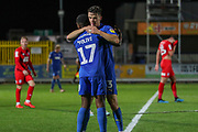 AFC Wimbledon midfielder Callum Reilly (33) celebrating after scoring goal to make it 3-0 during the Leasing.com EFL Trophy match between AFC Wimbledon and Leyton Orient at the Cherry Red Records Stadium, Kingston, England on 8 October 2019.