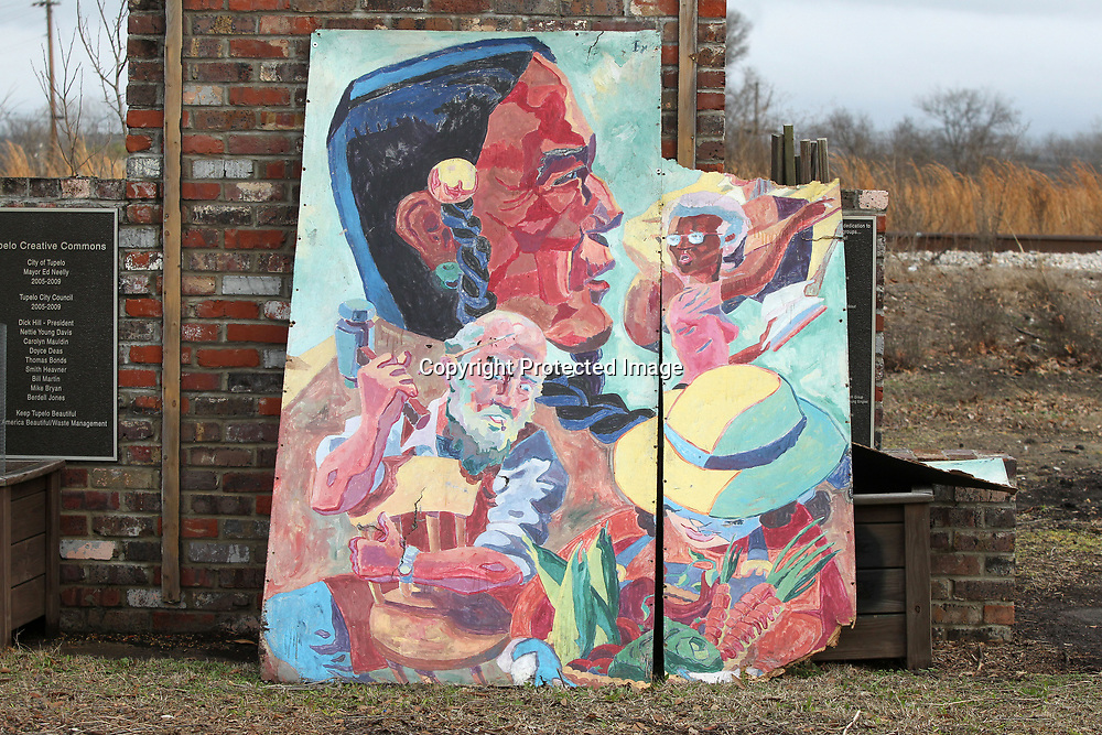The old mural from the community garden on Spring Street in Tupelo.