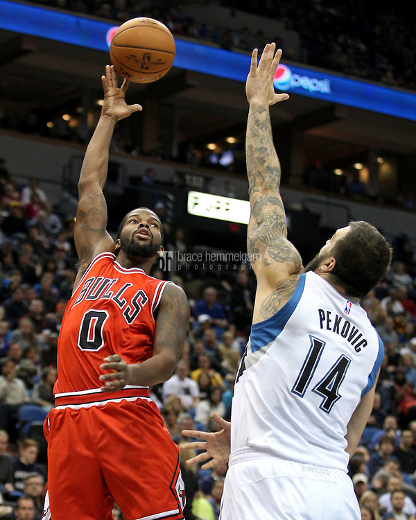 Nov 1, 2014; Minneapolis, MN, USA; Chicago Bulls guard Aaron Brooks (0) shoots over Minnesota Timberwolves center Nikola Pekovic (14) during the second quarter at Target Center. Mandatory Credit: Brace Hemmelgarn-USA TODAY Sports