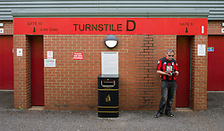 Bournemouth fan reads a program outside a turnstile prior to kick off. - Mandatory by-line: Alex James/JMP - 26/08/2017 - FOOTBALL - Vitality Stadium - Bournemouth, England - Bournemouth v Manchester City - Premier League
