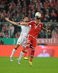 16.04.2014, Allianz Arena, Muenchen, GER, DFB Pokal, FC Bayern Muenchen vs 1. FC Kaiserslautern, Halbfinale, im Bild vl. Florian Dick (1.FC Kaiserslautern) und Mario Mandzukic (FC Bayern Muenchen) im Kopfballduell // during the DFB Pokal Halffinal match between FC Bayern Munich vs 1. FC Kaiserslautern at the Allianz Arena in Muenchen, Germany on 2014/04/16. EXPA Pictures © 2014, PhotoCredit: EXPA/ Eibner-Pressefoto/ Stuetzle<br /> <br /> *****ATTENTION - OUT of GER*****