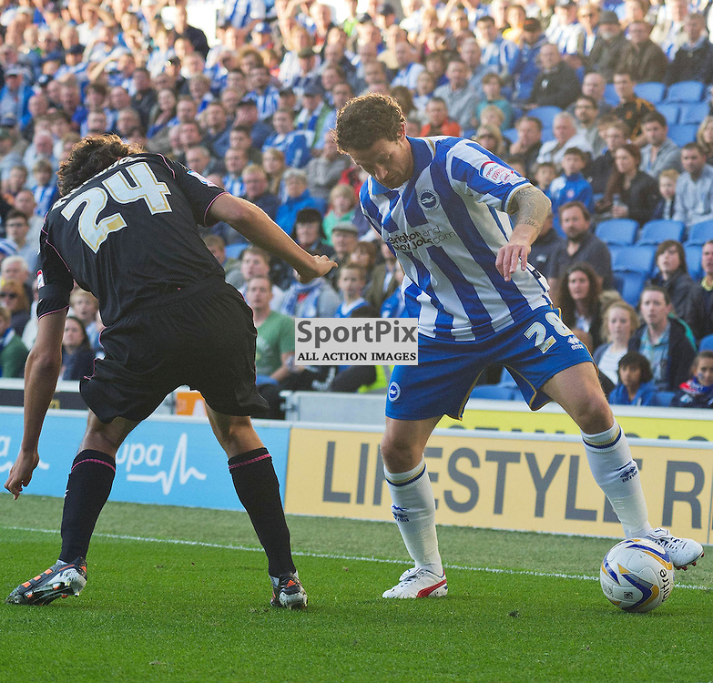 BRIGHTON. UK. 29/09/2012. Birmingham City's Will Packwood and Brighton and Hove Albion's Wayne Bridge at the match between Brighton and  Hove Albion FC and Birmingham City FC held at the American Express Community Stadium Falmer. © Peter Webb | STOCKPIX.EU. Photo credit: Peter Webb | STOCKPIX.EU