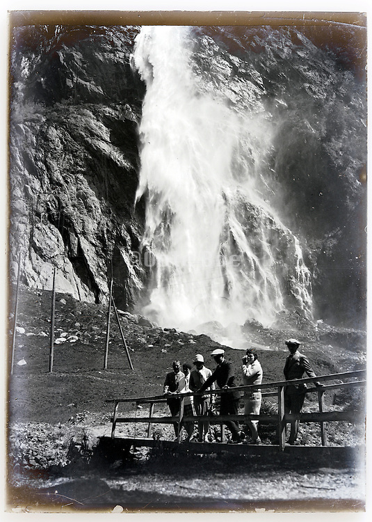 waterfall nature with tourists 1900s
