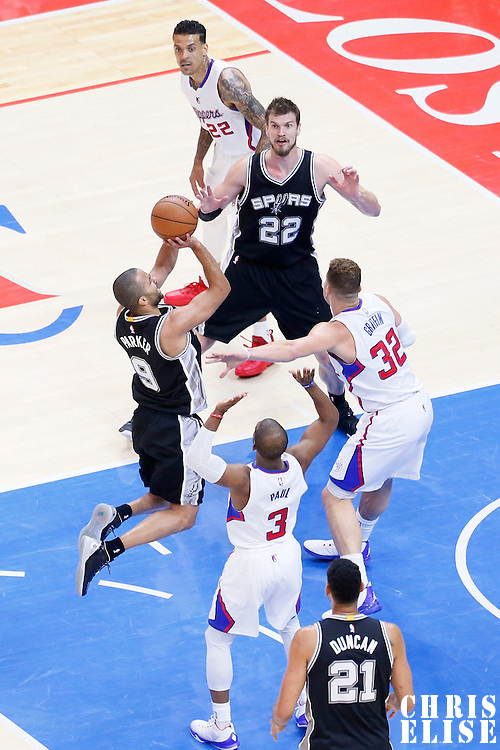 19 April 2014: San Antonio Spurs guard Tony Parker (9) takes a jump shot over Los Angeles Clippers forward Blake Griffin (32) and Los Angeles Clippers guard Chris Paul (3) during the Los Angeles Clippers 107-92 victory over the San Antonio Spurs, during Game One of the Western Conference Quarterfinals of the NBA Playoffs, at the Staples Center, Los Angeles, California, USA.