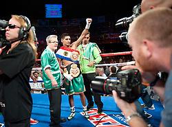 Las Vegas, NV:  In a jr welterweight unification clash, WBA champion Amir Khan (26-1, 18 KOs) scored a dominating fifth round KO against IBF champion Zab Judah (41-7, 28 KOs).
