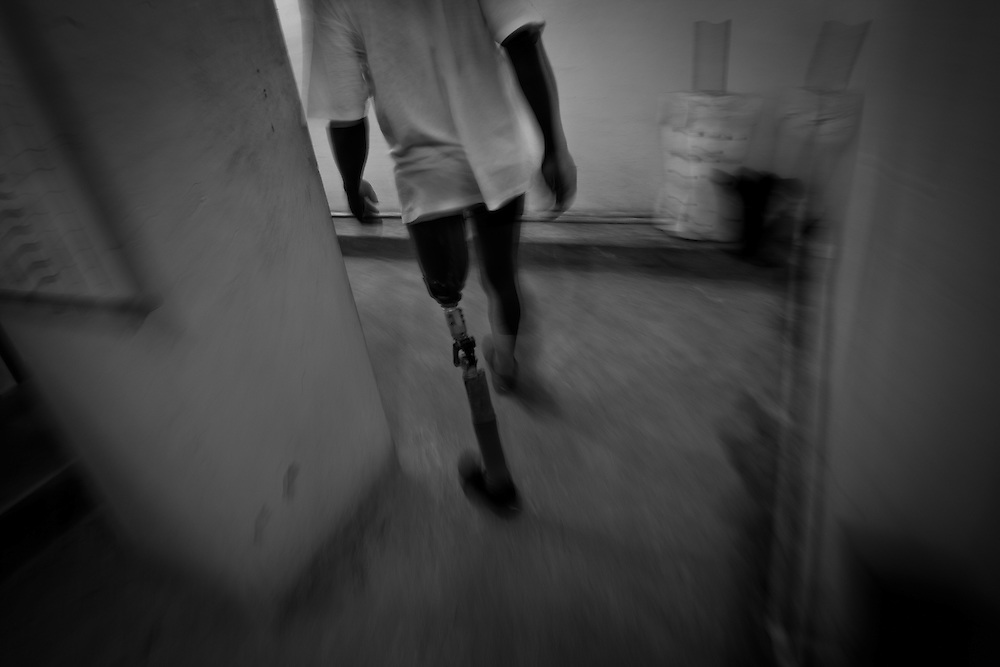A patient practice walking with his prosthetic leg at Healing Hands Haiti Clinic. <br /> <br /> Healing Hands Haiti (HHH) in Port Au Prince has been established for 12 years since 1999. Currently, HHH is constructing a new facility in Port Au Prince because their old clinic was destroyed from the earthquake.   HHH provides physical therapy, counseling, prosthetics, and support for free or very little cost to Haitians.  Their funding comes from private donations and organizations such as Handicap International, Mission Europeene Aide Humanitarian, International Committee of the Red Cross (ICRC), American Red Cross, Newman's Own, Direct Relief International (DRI), SOROS Open Society Foundation, and USAID which pays for employees, doctors, supplies, and facilities.  The motto of HHH is &quot;to serve the people of Haiti is to enable them to help themselves.&quot;   Thus, most of their employees are Haitians with very few foreign expats. Furthermore, HHH recruits and teaches young Haitian students prosthetic and orthotic skills and physical therapy in a specialized program that will enable them to earn a degree approved by World Health Organization.