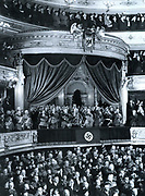 Chancellor Adolf Hitler is greeted by an audience in a theatre in Germany c1935. Key Nazi leaders attending are seen in the State Official Box. Left to right: Josef Goebbels, Rudolf Hess, Herman Göring, Field Marshall Von Mackensen, Adolf Hitler, General