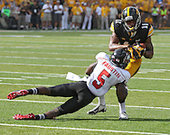 August 31 2013: Iowa Hawkeyes wide receiver Kevonte Martin-Manley (11) is hit by Northern Illinois Huskies cornerback Jhony Faustin (5) after a catch during the second quarter of the NCAA football game between the Northern Illinois Huskies and the Iowa Hawkeyes at Kinnick Stadium in Iowa City, Iowa on August 31, 2013. Northern Illinois defeated Iowa 30-27.