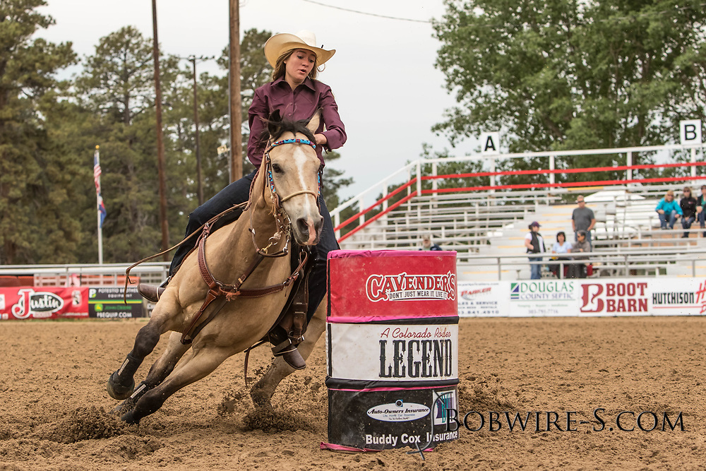 Rachel Spight makes her barrel racing run during slack at the Elizabeth Stampede on Sunday, June 3, 2018.