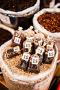 Dried red and black Kampot peppercorns at central market in Kampot