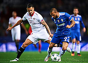 "SEVILLE, SPAIN - NOVEMBER 22:  Victor Machin Perez ""Vitolo"" of Sevilla FC (L) competes for the ball with Daniel Alves of Juventus (R) during the UEFA Champions League match between Sevilla FC and Juventus at Estadio Ramon Sanchez Pizjuan on November 22, 2016 in Seville, .  (Photo by Aitor Alcalde/Getty Images)"