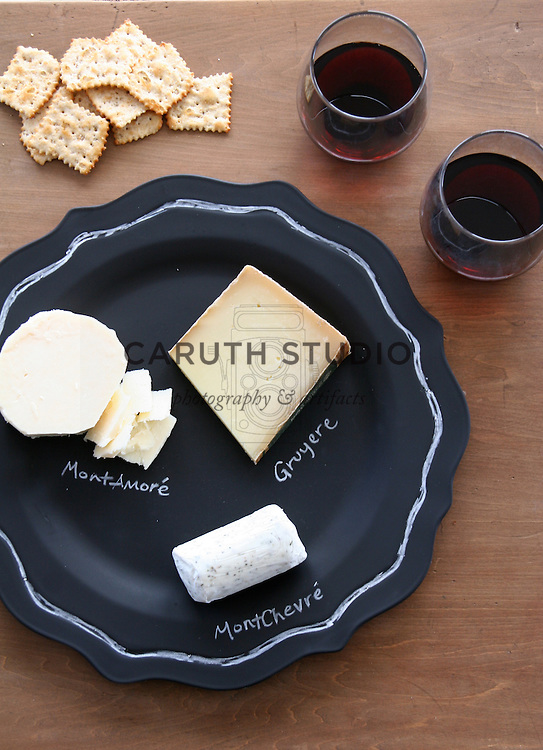 Painted chalkboard platter set for wine and cheese party