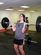 (from left) Gabi Sawyer, Anne Keeton and Alyssa Medeiros during a workout of the day session at Vigor Crossfit in Moraine, Wednesday, January 25, 2012.