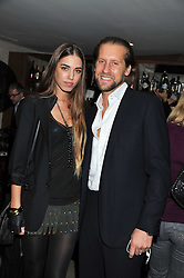 AMBER LE BON and JAKE PARKINSON-SMITH at a party to launch Senkai - London's first modern Japanese-inspired restaurant at 65 Regent Street, London on 26th October 2011.