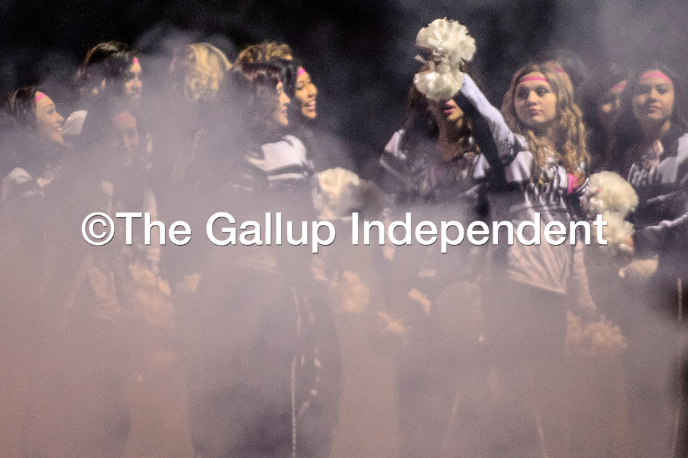 Members of the Gallup High School Bengal Girls dance team turn to greet the players as they enter Public School Stadium to face the Miyamura Patriots Friday in Gallup.