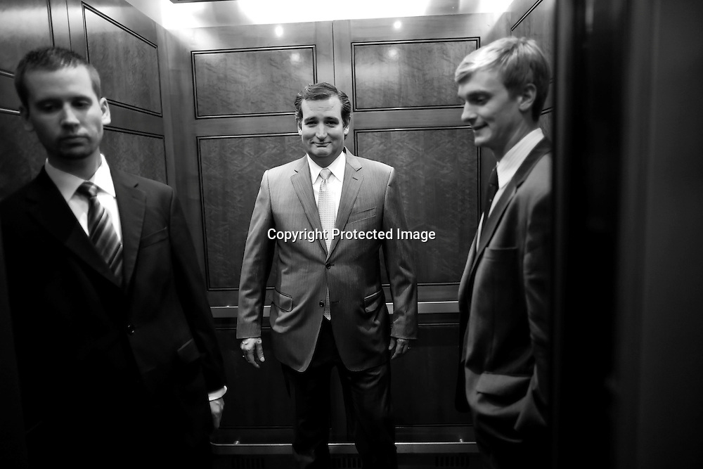 U.S. Senator Ted Cruz (R-TX) (C) departs the Senate floor after a late-night vote rejected budget legislation from the Republican-controlled House of Representatives at the U.S. Capitol in Washington, September 30, 2013. The U.S. government was on the edge of a major shutdown as Congress remained in partisan deadlock on Monday over Republican efforts to halt to President Barack Obama's healthcare reforms using a temporary spending bill.
