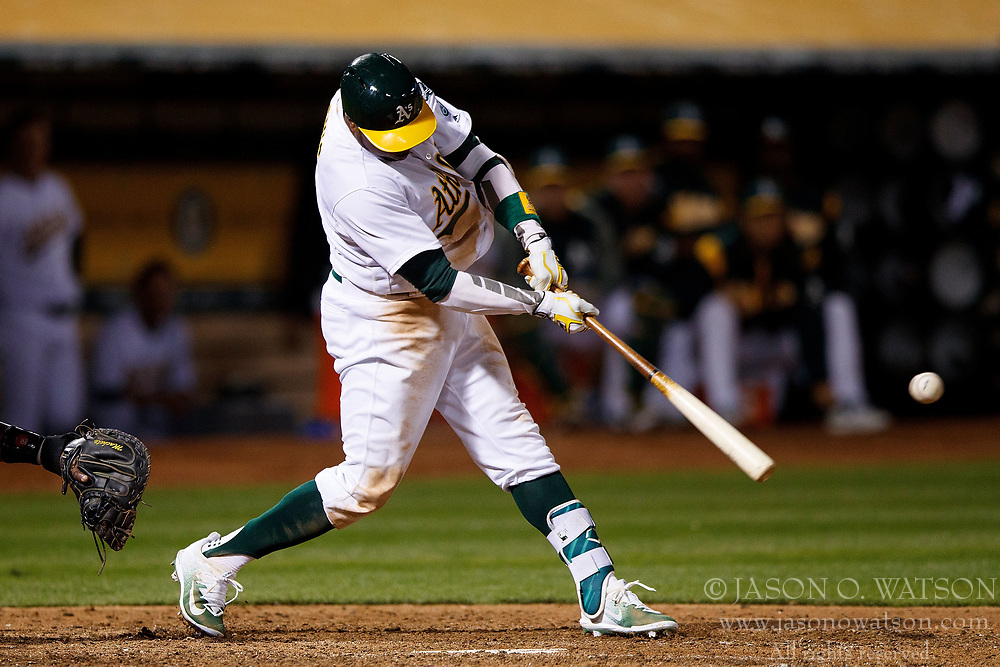 OAKLAND, CA - APRIL 04:  Rajai Davis #11 of the Oakland Athletics hits a two run triple against the Los Angeles Angels of Anaheim during the seventh inning at the Oakland Coliseum on April 4, 2017 in Oakland, California. The Los Angeles Angels of Anaheim defeated the Oakland Athletics 7-6. (Photo by Jason O. Watson/Getty Images) *** Local Caption *** Rajai Davis