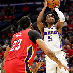 Oct 19, 2018; New Orleans, LA, USA; Sacramento Kings guard De'Aaron Fox (5) shoots over New Orleans Pelicans forward Anthony Davis (23) during the second quarter at the Smoothie King Center. Mandatory Credit: Derick E. Hingle-USA TODAY Sports
