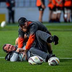 Assistant coach Ian Foster tussles with Tawerra Kerr-Barlow during the 2017 DHL Lions Series NZ All Blacks captain's run at Eden Park in Auckland, New Zealand on Friday, 7 July 2017. Photo: Dave Lintott / lintottphoto.co.nz