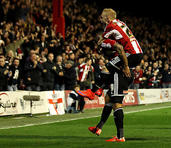Brentford's Andre Gray celebrates with Brentford's Alex Pritchard - Photo mandatory by-line: Robbie Stephenson/JMP - Mobile: 07966 386802 - 08/05/2015 - SPORT - Football - Brentford - Griffin Park - Brentford v Middlesbrough - Sky Bet Championship