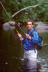 one man fly fishing in a stream