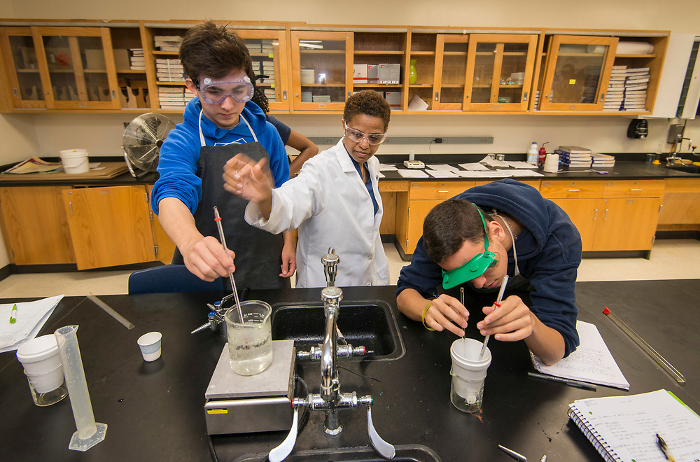 Students work on a specific heat experiment at the DeBakey High School for Health Professionals, April 12, 2017, in Houston.