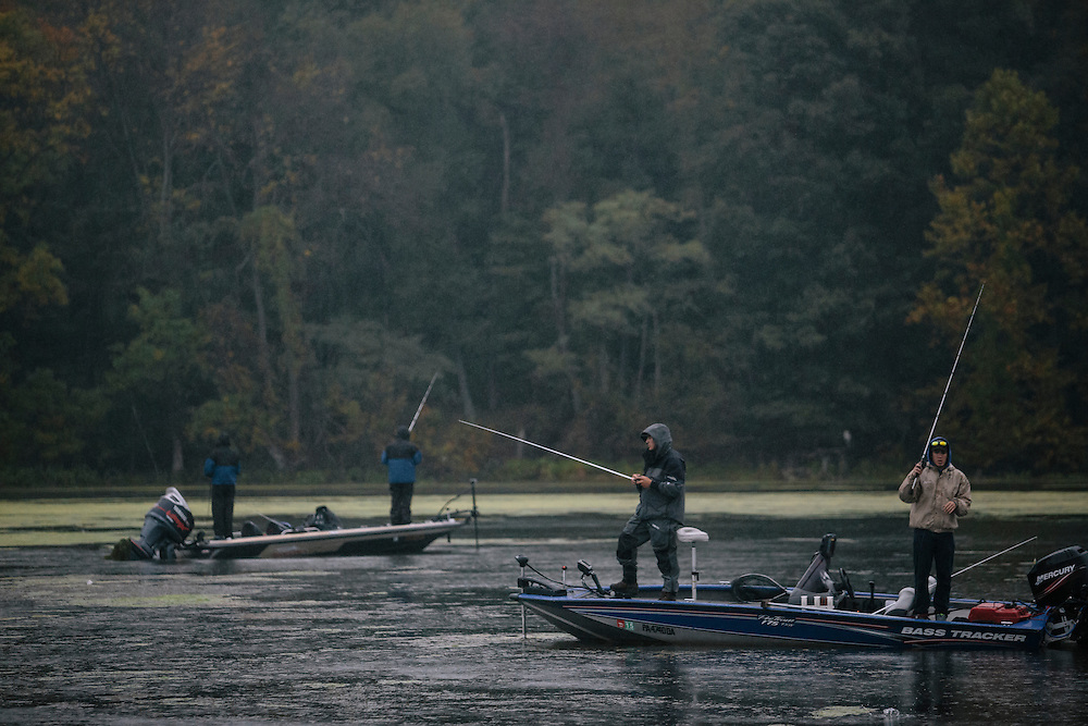 Mike Longacre, center, and Jake Ball, right, of State University of New York-College of Environmental Science and Forestry, fish for bass during the FLW College Fishing Northern Conference Invitational in Marbury, MD on Oct. 11, 2014. Only the top 15 of 43 teams moved on to Sunday.
