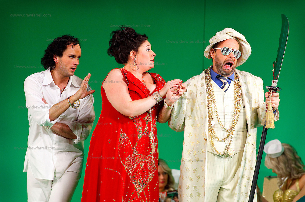 Picture shows : Thomas Walker as Lindoro, Karen Cargill as Isabella and Adrian Powter as Taddeo..Picture  ©  Drew Farrell Tel : 07721 -735041..A new Scottish Opera production of  Rossini's 'The Italian Girl in Algiers' opens at The Theatre Royal Glasgow on Wednesday 21st October 2009..(Soap) opera as you've never seen it before.Tonight on Algiers.....Colin McColl's cheeky take on Rossini's comic opera is a riot of bunny girls, beach balls, and small screen heroes with big screen egos. Set in a TV studio during the filming of popular Latino soap, Algiers, the show pits Rossini's typically playful and lyrical music against the shoreline shenanigans of cast and crew. You'd think the scandal would be confined to the outrageous storylines, but there's as much action off set as there is on.... .Italian bass Tiziano Bracci makes his UK debut in the role of Mustafa. Scottish mezzo-soprano Karen Cargill, who the Guardian called a 'bright star' for her performance as Rosina in Scottish Opera's 2007 production of The Barber of Seville, sings Isabella. .Cast .Mustafa...Tiziano Bracci.Isabella..Karen Cargill.Lindoro...Thomas Walker.Elvira...Mary O'Sullivan.Zulma...Julia Riley.Haly...Paul Carey Jones.Taddeo...Adrian Powter. .Conductors.Wyn Davies.Derek Clarke (Nov 14). .Director by Colin McColl.Set and Lighting Designer by Tony Rabbit.Costume Designer by Nic Smillie..New co-production with New Zealand Opera.Production supported by.The Scottish Opera Syndicate.Sung in Italian with English supertitles..Performances.Theatre Royal, Glasgow - October 21, 25,29,31..Eden Court, Inverness - November 7. .His Majesty's Theatre, Aberdeen  - November 14..Festival Theatre,Edinburgh - November 21, 25, 27 ...Note to Editors:  This image is free to be used editorially in the promotion of Scottish Opera. Without prejudice ALL other licences without prior consent will be deemed a breach of copyright under the 1988. Copyright Design and Patents Act  and will be subject to payment or legal action, w