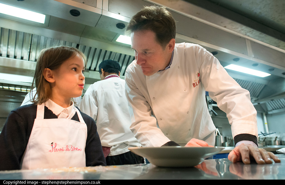 © Licensed to London News Pictures. 03/11/2014. Oxford, UK. NICK CLEGG (R) cooks a ravioli dish with local school girl Miriam Willis aged 9.  To celebrate National School Meals Week (3-7 November), the Deputy Prime Minister, Nick Clegg, joins school children at Brasserie Blanc in Oxford to get some top cooking tips from Raymond Blanc. The visit is part of a larger national effort to raise awareness of and enhance children's relationship with food. The Deputy Prime Minister has called on celebrity chefs to lead the way by joining forces with school cooks to promote the great school lunch. School cooks up and down the country will be taking their skills out of the school kitchen to showcase to parents and pupils the variety and quality of food now being served in schools. National School Meals Week comes just months after the launch of free school meals for 2.8 million primary school children and the introduction of cooking in the curriculum.. Photo credit : Stephen Simpson/LNP
